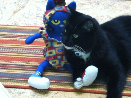 Rico hanging out with my SPCA mascot from last year, Pete the Cat